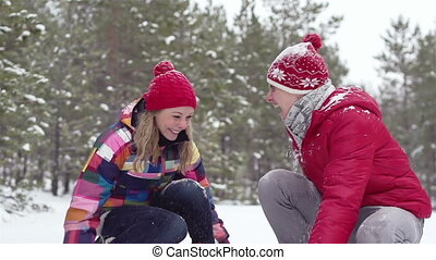 Snow Fight - Cheerful friends playfully fighting each other...