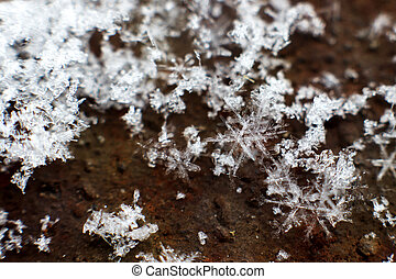 snow flake macro. amazing crystal closeup on old windowsill, space for text. snowy winter. seasonal time