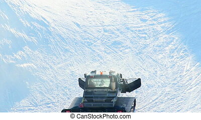 """Snow groomer, piste basher cleaning skiing run, winter..."