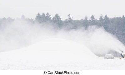 snow gun making hill outdoors in winter - winter, season and...