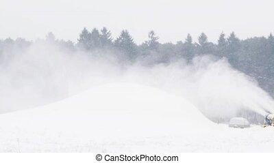 snow gun making hill outdoors in winter