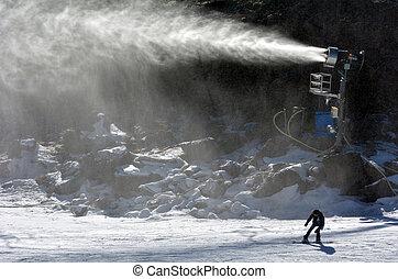 Snowmaker - Snow Gun Snowmaker throw snow over a snowboarder