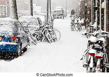 Snow in the city - streetview with bikes during snowstorm - horizontal