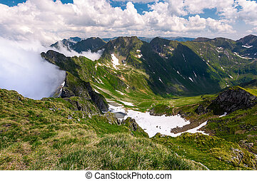 snow in the valley of Fagaras mountains. beautiful summer...