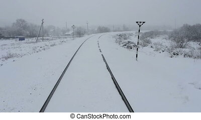 Snow is on the background of the wooden railway tracks