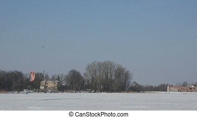 snow kiting  on the winter lak