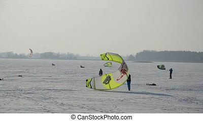 snow kiting on winter lake ice