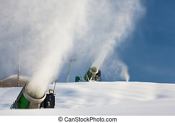 Snow-machine bursting artificial snow  over a skiing slope