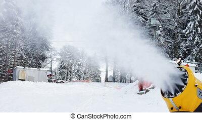 Snow machine gun on a ski slope.