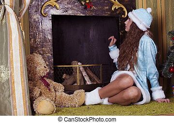 Snow-maiden  looking into fireplace chimney