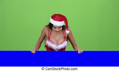 Snow maiden looks out of the blue board and shows a thumbs up. Green screen