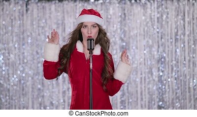 Snow maiden sings in a retro microphone and dances with...