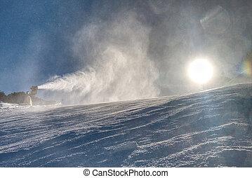 Snow maker machine works (snow gun or snow cannon) at ski...