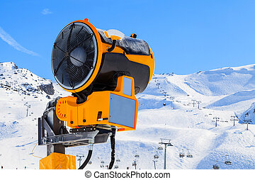 Snow maker - Yellow snow maker in a ski resort