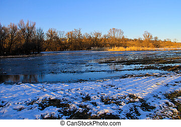 Snow melting on the meadow