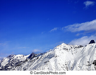 Snow mountain at sunny winter day.