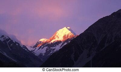 Snow mountain on sunset in sunlight panorama in New Zealand.