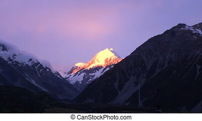 Snow mountain on sunset in sunlight panorama in New Zealand.