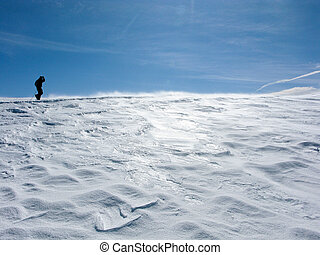 Snowy mountains in the pyrenees, Spain. with lonely hiking person
