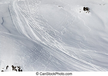 Snow off-piste slope with traces of skis and snowboards