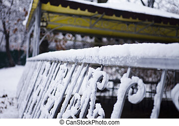 Snow on a fencing
