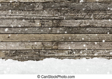 snow on a wooden fence as background image - Pile of snow...
