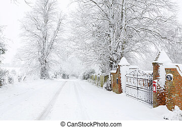 Snow on British country road in winter