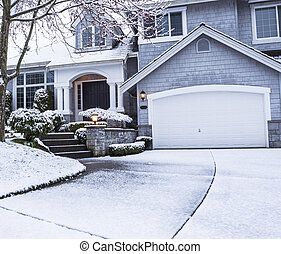 Snow on Driveway leading to home