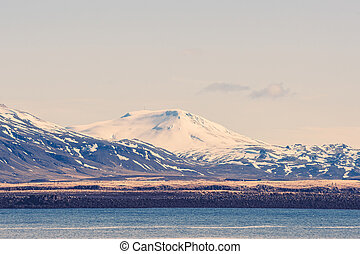Snow on mountains by the sea