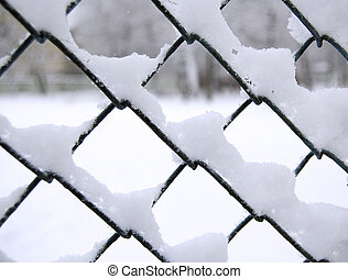 snow on net - metall net covered snow