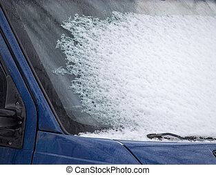 Snow on the window of car in winter