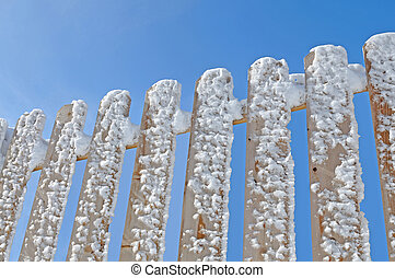 snow on the wooden fence