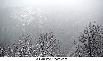 Snow over the ancient village of Sacred Mount of Varese,...