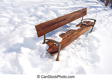 Snow park bench isolated on the white