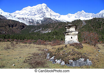 Manaslu and stupa - Snow peaks of mount Manaslu and stupa in...