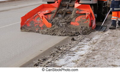 Snow-plough is working on street