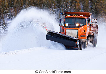 Snow plow clearing road after winter snow storm