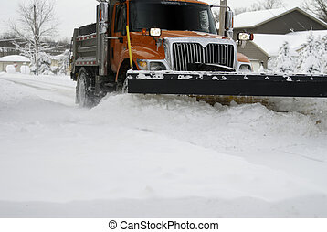 Up close image of a snow plow moving snow during a blizzard