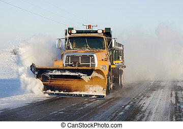 Snow plower on rural road