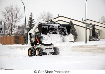 Snow removal - Bob cat removing snow.
