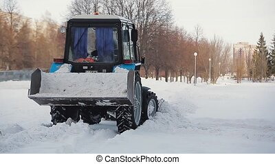Snow removal in the winter. Snow removal. Tractor with...