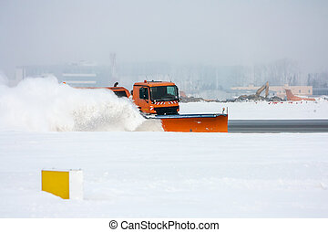 Snow-removal machine cleans the runway at the airport