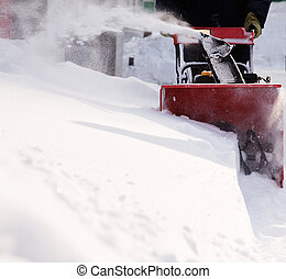 snow removal - winter concept, focus point on machine...