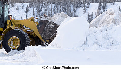 Snow removal with loader machinery after blizzard