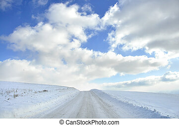 Snow Scape Beauty - Snow covered isolated country road with ...