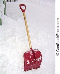Snow shovel left in the snow