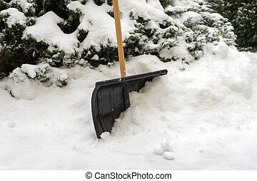 Snow Shovel - Snow shovel stuck in the snow