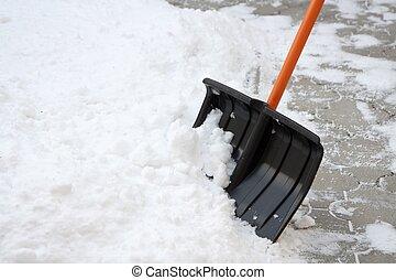 Snow shovel - Using snow shovel on a backyard