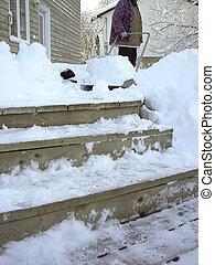 Snow Shoveling - o2 - Shoveling snow off deck.