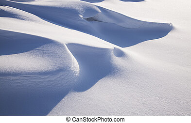 a snowdrift formed after a snow storm and a strong wind